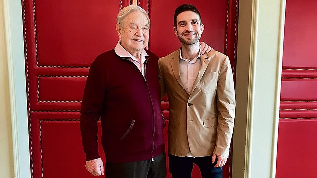 George and Alexander Soros in Berlin last week. 'My father is completely different from the image people have of him' (Photo Nahum Barnea)