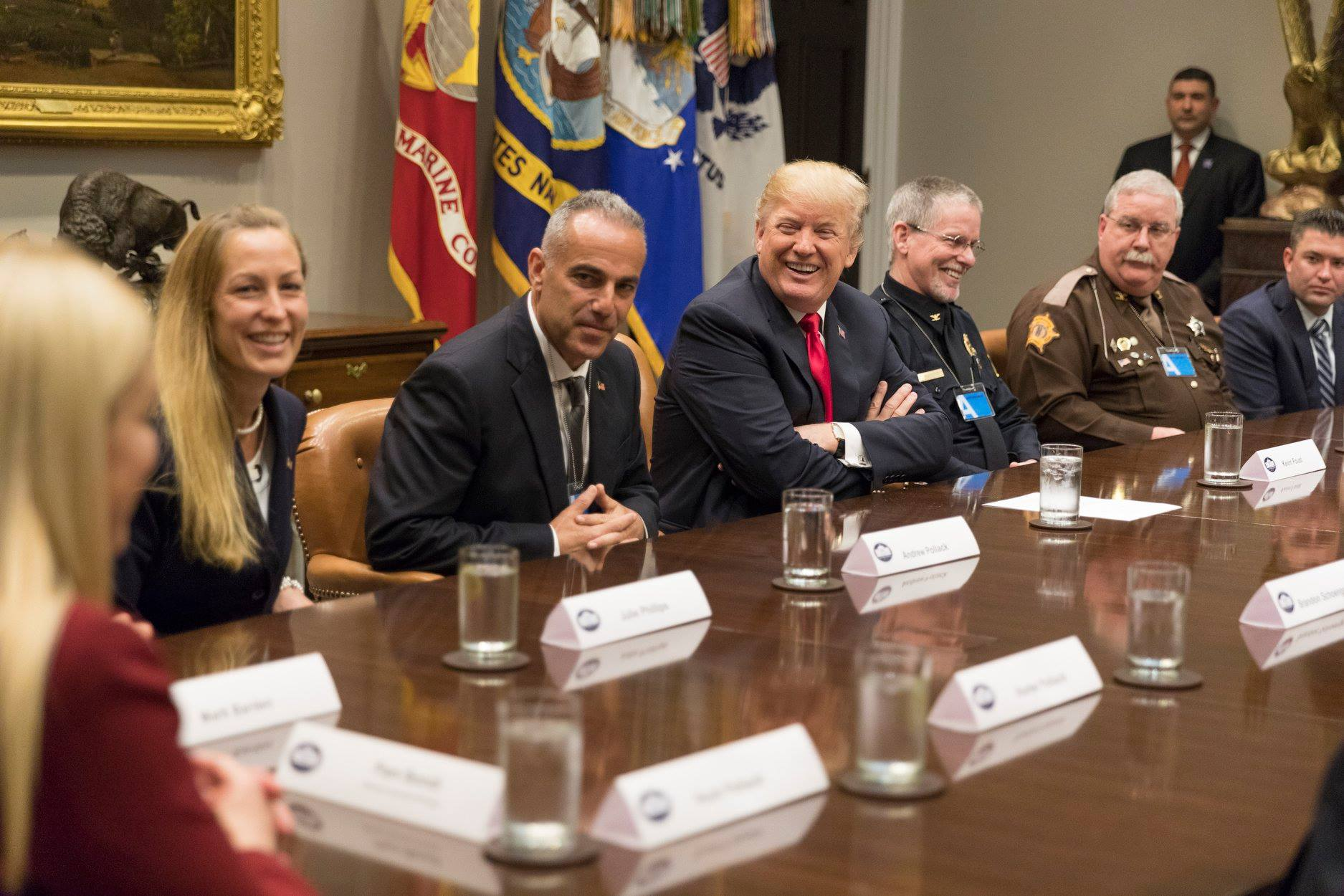 Andrew_Pollack and his wife, sitting along side President Trump and others.